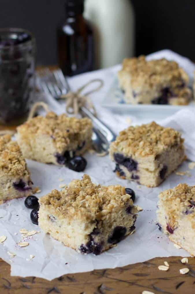 squares of blueberry cake on parchment