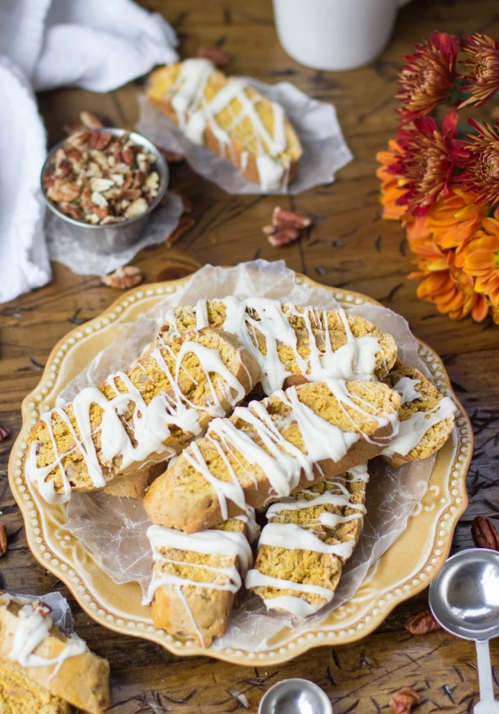 pumpkin biscotti drizzled with white chocolate on orange plate