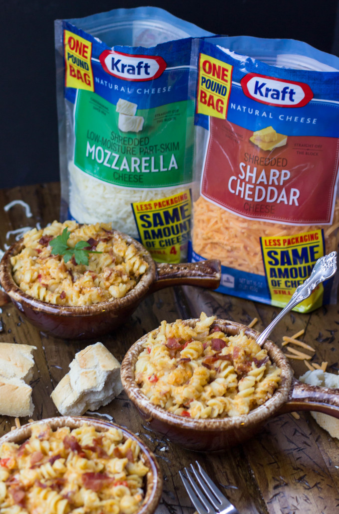 Bacon Macaroni & Cheese in crocks with kraft cheese in background