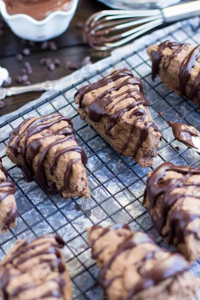 chocolate scones with drizzle on cooling rack