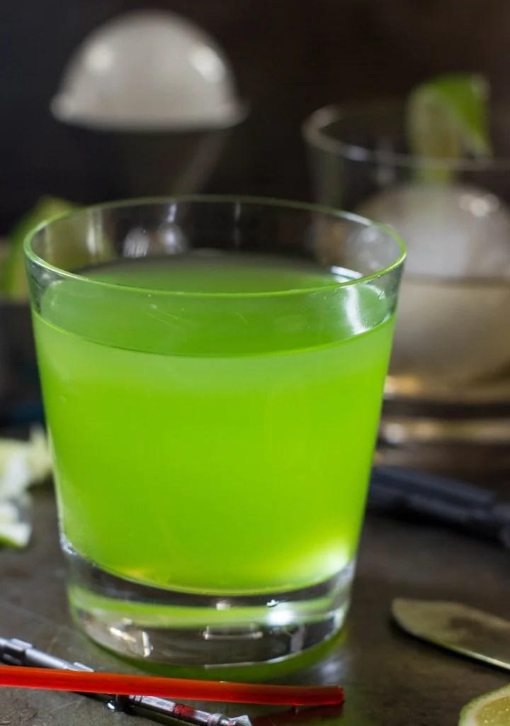green midori sour in glass