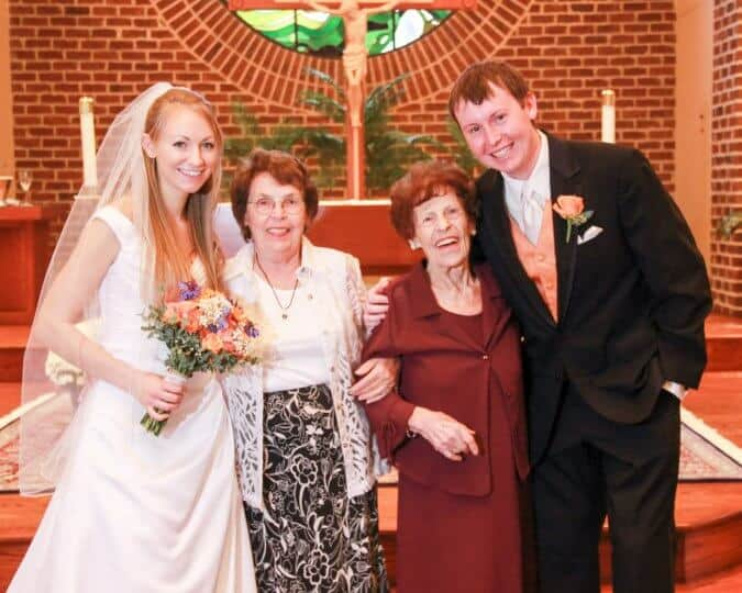 bride and groom at alter with grandmother and great-grandmother
