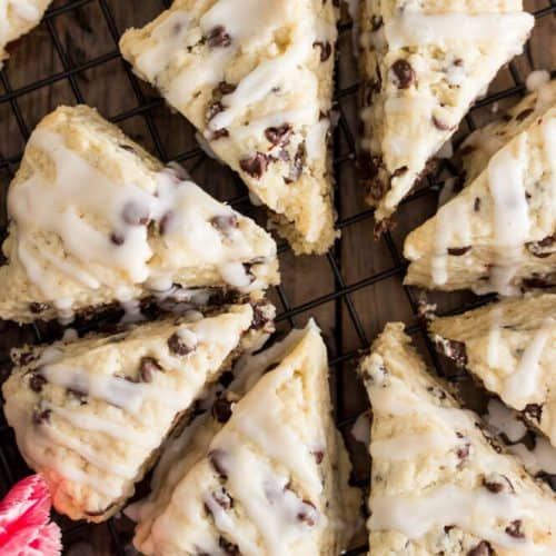 Overhead shot of chocolate chip scones, drizzled with glaze