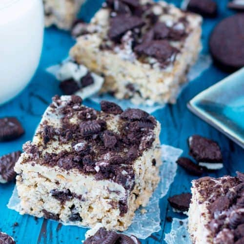 Cookies and cream rice krispie squares, surrounded by chopped oreo cookies