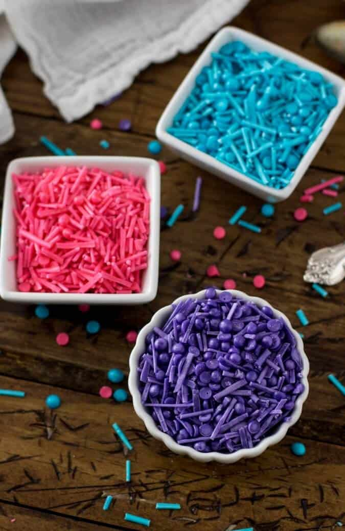 pink blue and purple homemade sprinkles in white dishes