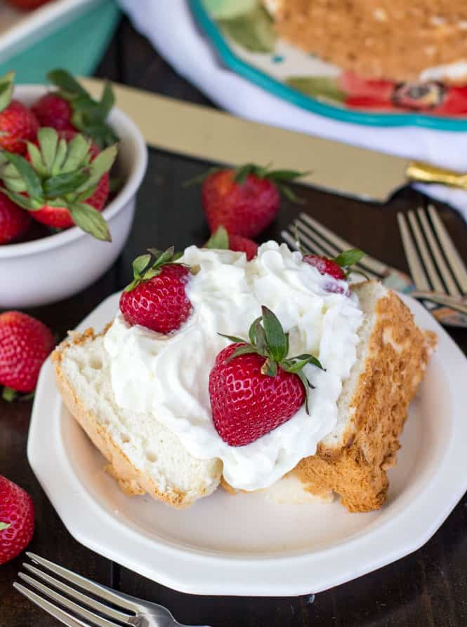 The best angel food cake topped with strawberries and whipped cream