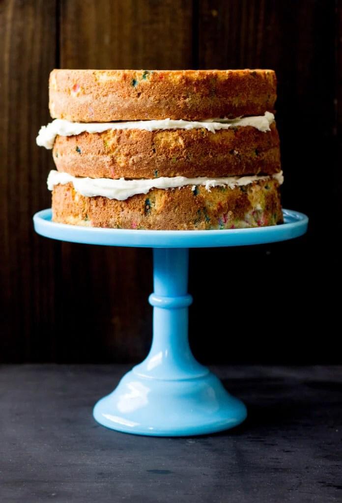 Freshly baked stack of funfetti cake layers    Sugar Spun Run