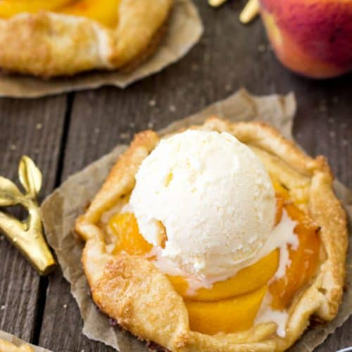 Peaches and cream galette, topped with a scoop of ice cream