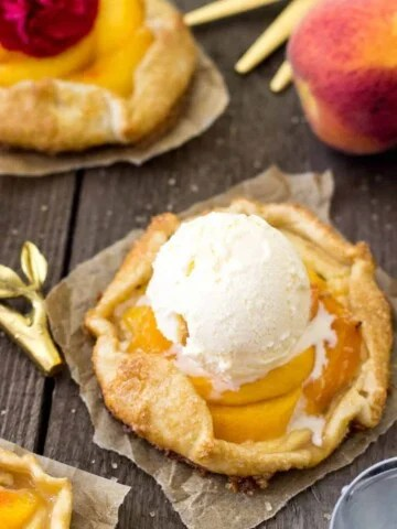 Peaches and cream galette with a scoop of vanilla ice cream on top