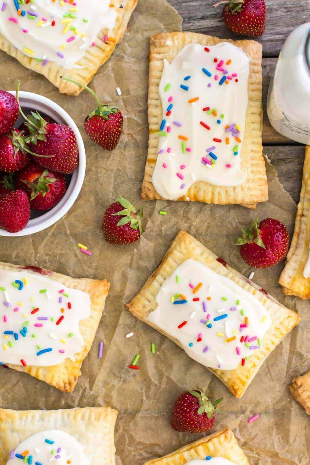 overhead of homemade Strawberry Pop Tarts on parchment paper
