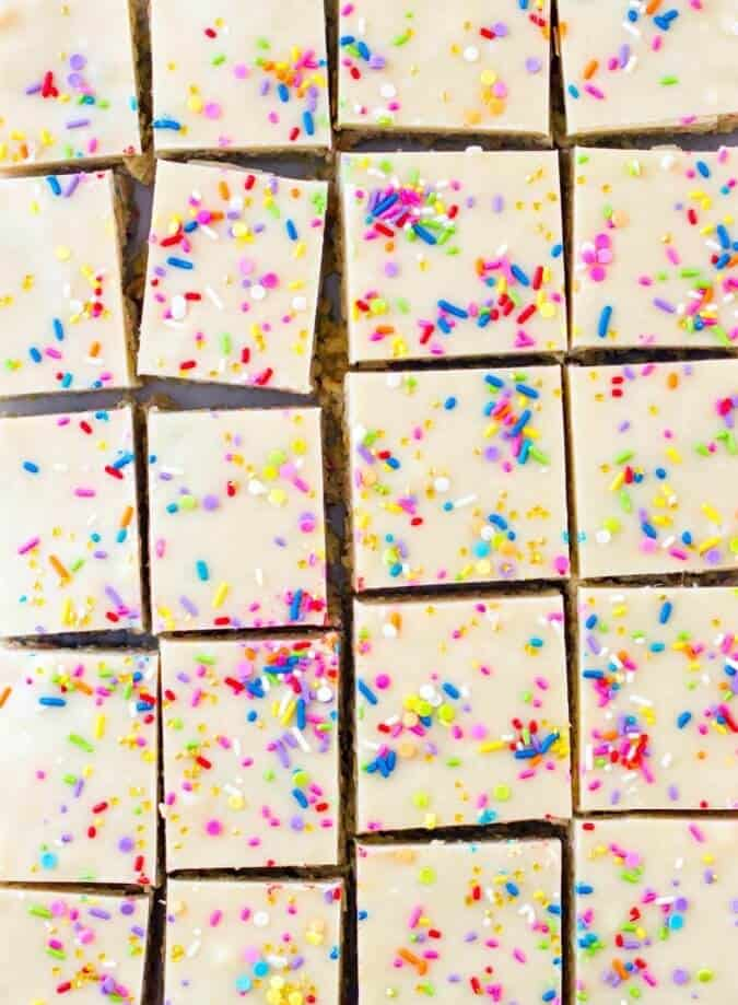 Overhead of cake batter rice krispie treats, cut in to squares