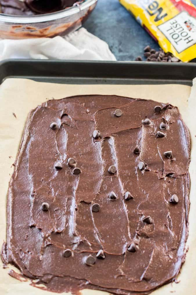 making brownie brittle: spread batter thin and top with chocolate chips