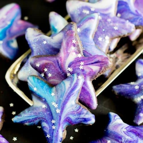 Star shaped galaxy cookies stacked on a silver tray