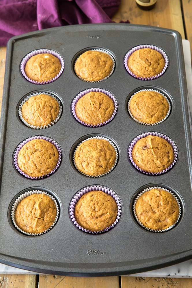 Cupcake tin with 12 freshly baked pumpkin muffins