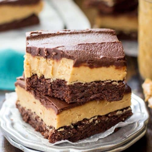Two buckeye brownies stacked on a silver plate