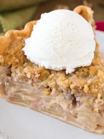 slice of apple pie with ice cream on white plate