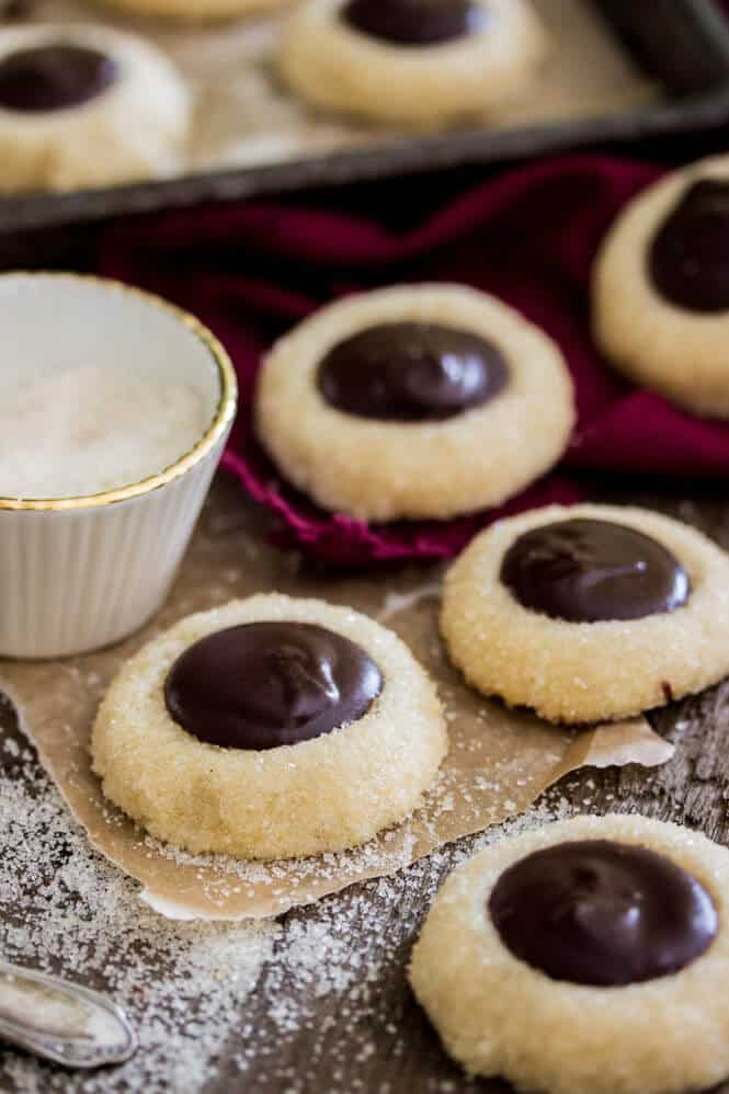 Chocolate Thumbprint Cookies -- Make sure you add a little bourbon to the ganache, it's amazing! || Sugar Spun Run