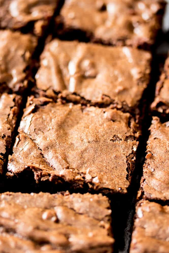 Overhead of freshly cut brownies with crackly tops