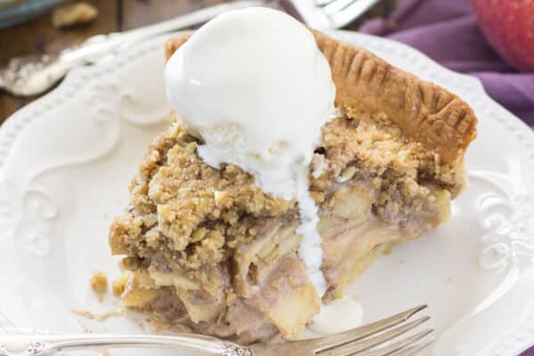 Slice of apple pie topped with ice cream