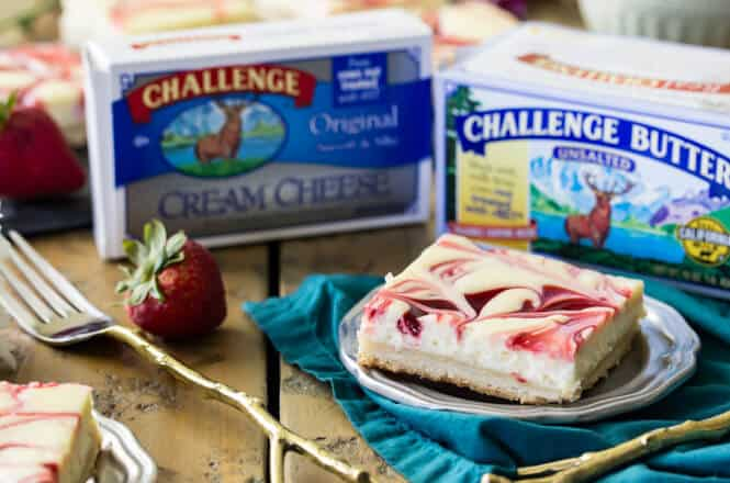 Berry Swirl Cheesecake Bars, a strawberry swirled lemon cheesecake on a shortbread crust