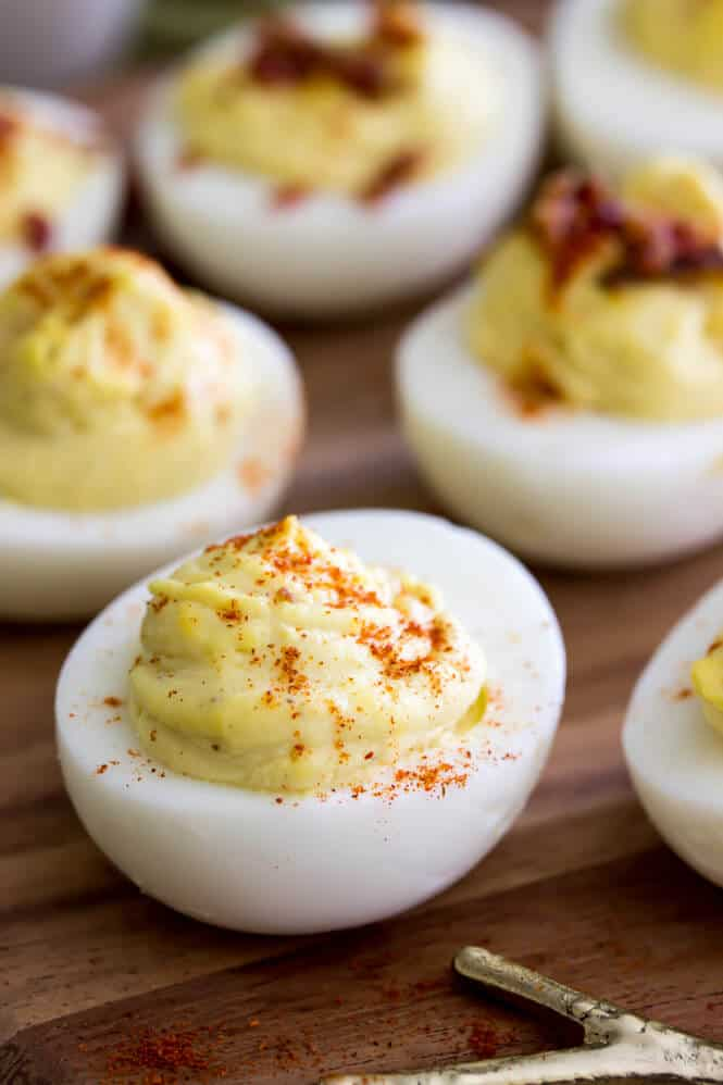 Deviled eggs topped with paprika