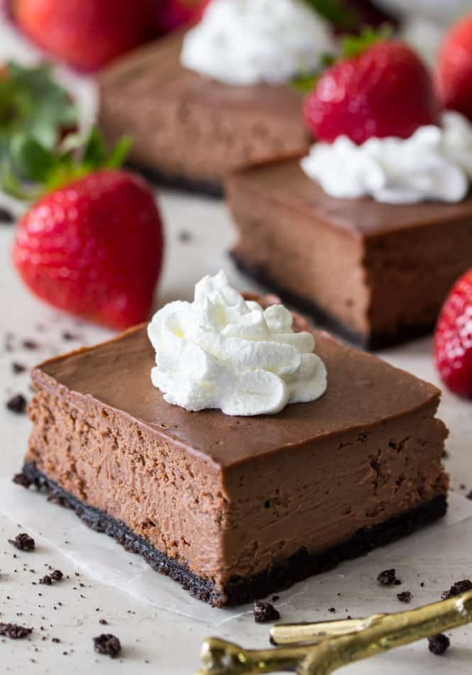 Chocolate cheesecake bar topped with whipped cream