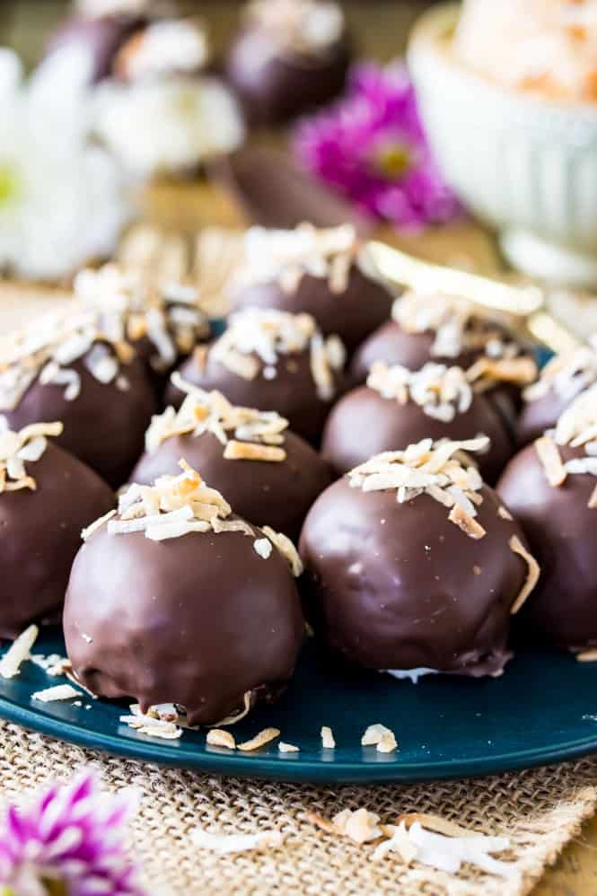 Homemade coconut truffles topped with toasted coconut