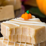 pumpkin fudge stacked on top of each other with bite missing from top piece