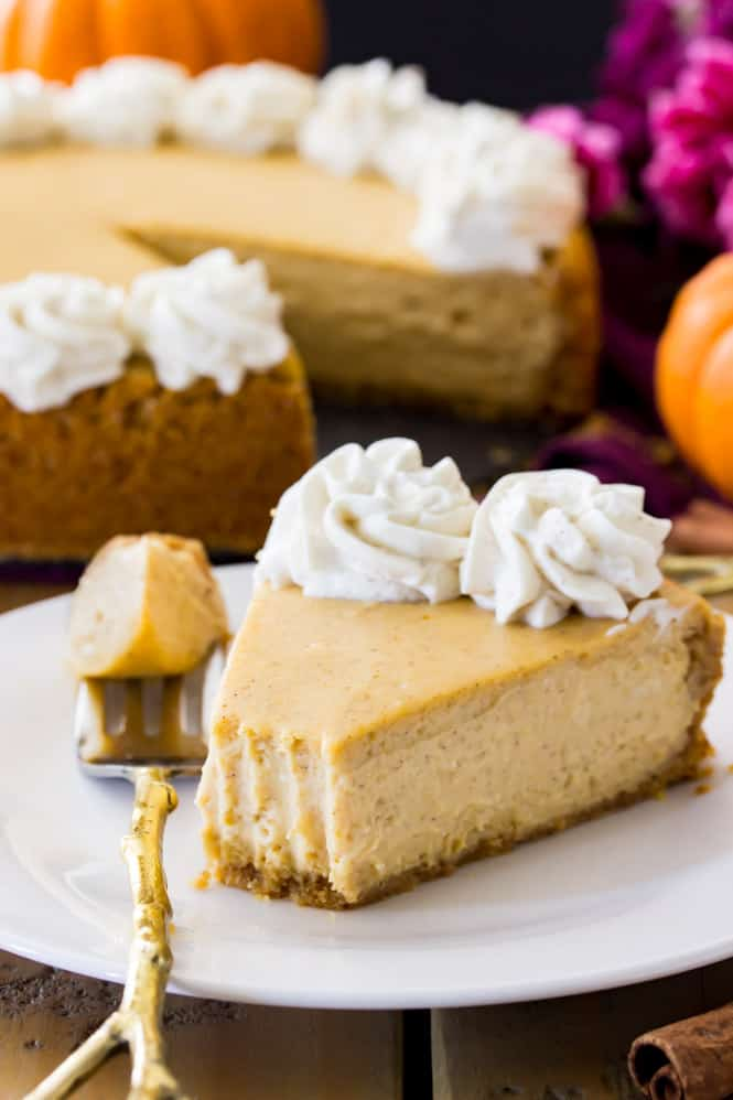 Pumpkin cheesecake on white plate, one of 12 top pumpkin recipes for fall