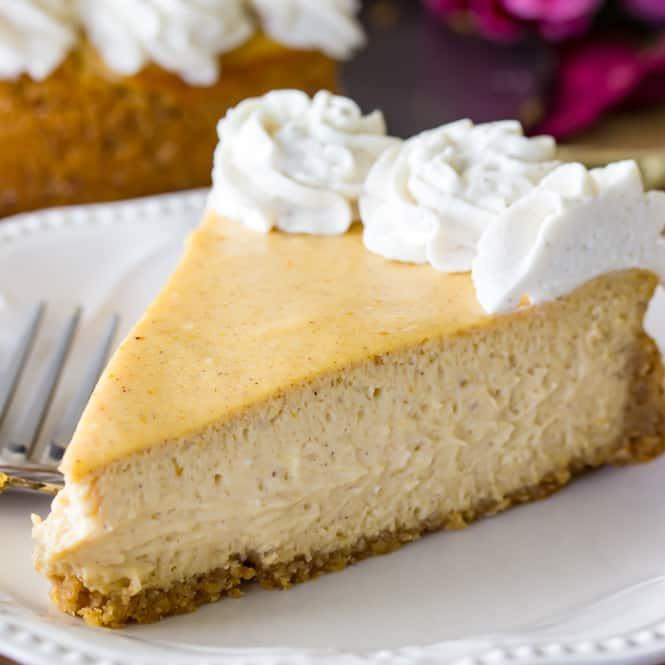 Slice of pumpkin cheesecake on plate