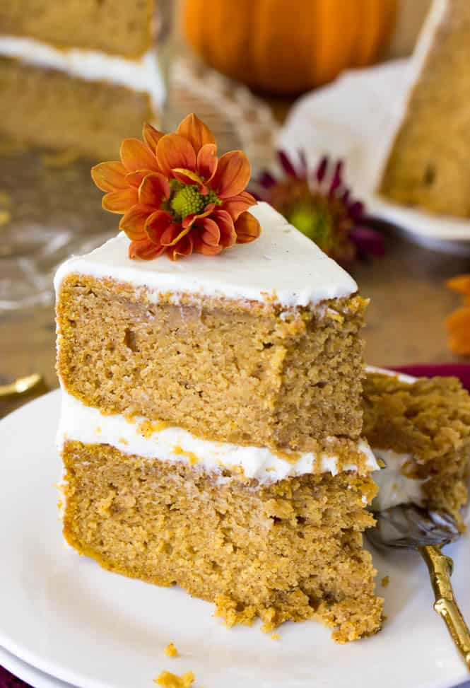 Pumpkin layer cake on white plate, one of 12 pumpkin recipes listed