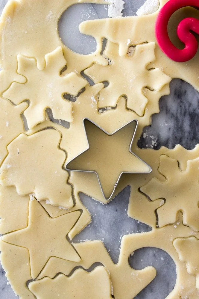 How to make sugar cookies: rolling out dough and cutting with cookie cutters