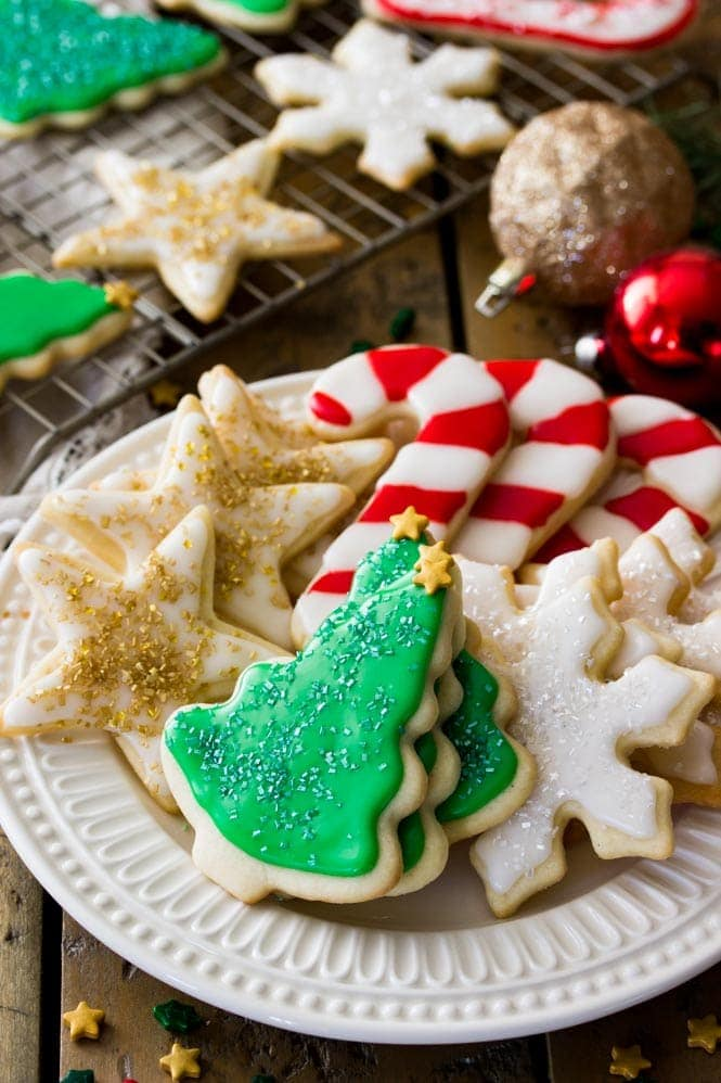 Decorated iced sugar cookies on display, showcasing the shiny frosting and the well-defined shapes of the cookies