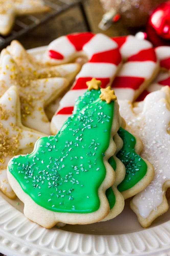 Sugar cookies shaped and decorated as stars, candy canes, snowflakes and christmas trees