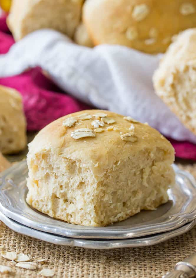 Soft and fluffy honey wheat rolls brushed with honey and topped with oats