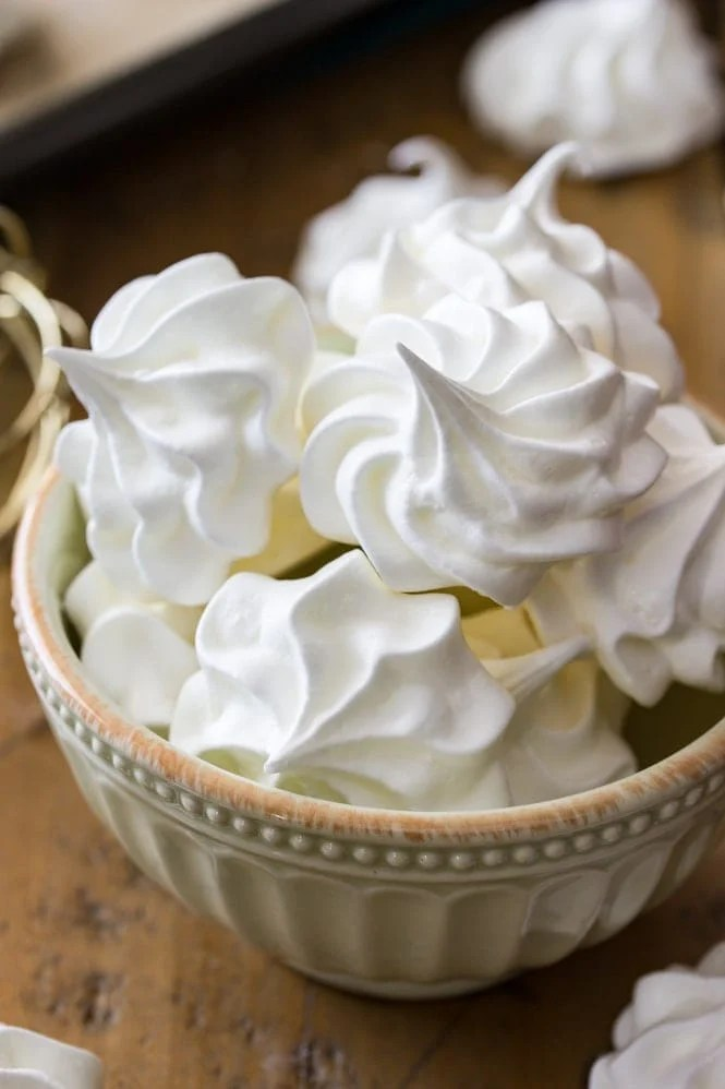 A bowl of white meringue cookies