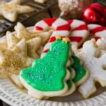 christmas sugar cookie decorated with icing on white plate