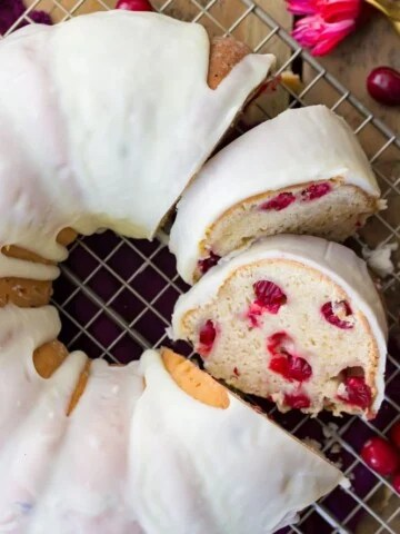 Overhead image of sliced, iced cranberry bundt cake
