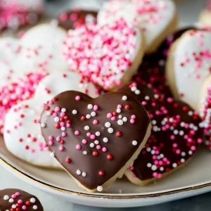 Heart shaped cookies with icing and sprinkles