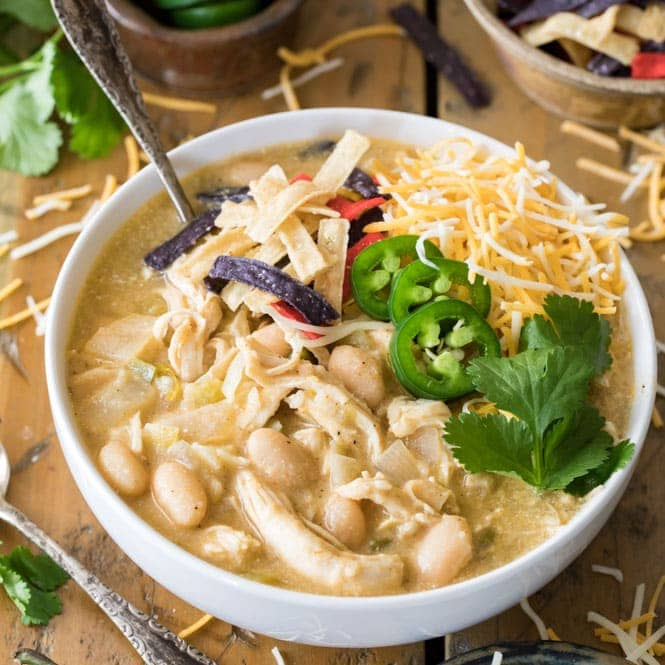 White Chicken chili in a bowl with toppings