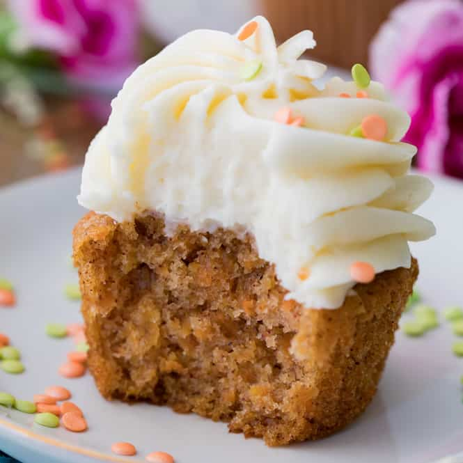Carrot cake cupcake with white frosting on a plate