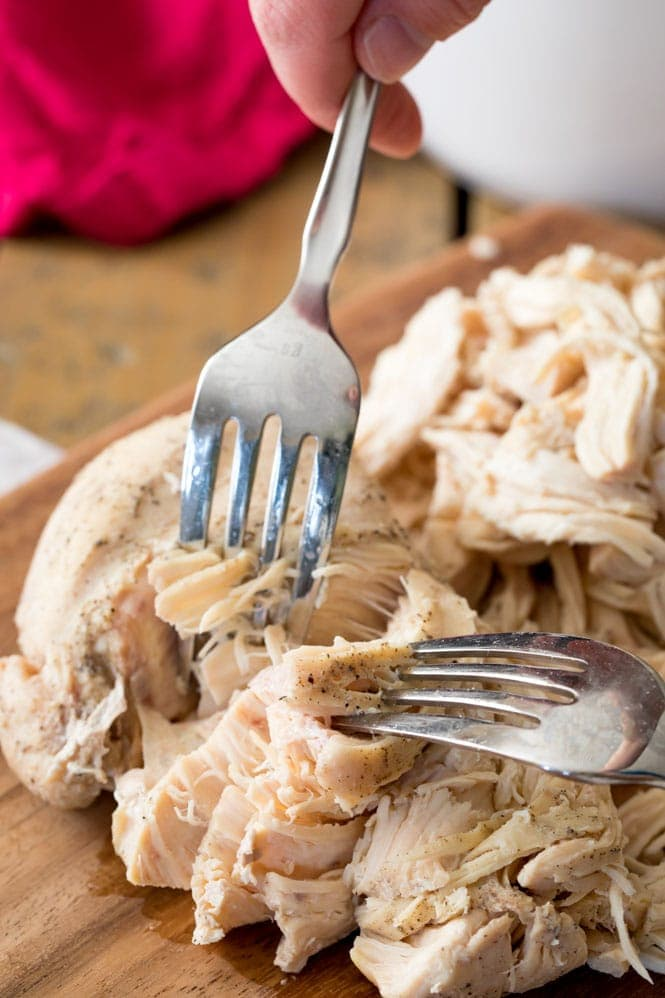 Shredding a chicken breast with two forks