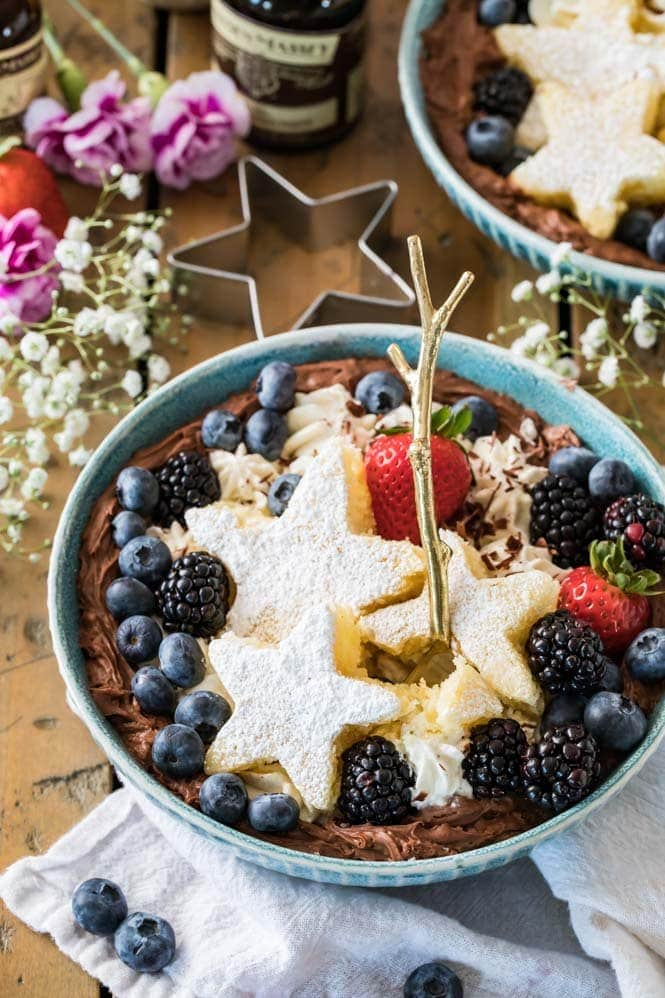A dessert bowl with a bite out of the cake