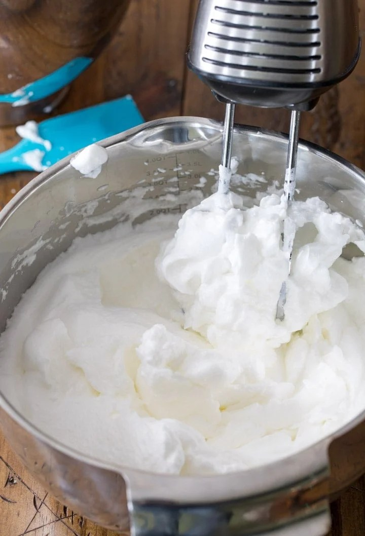Whipping egg whites to stiff peaks for white cake
