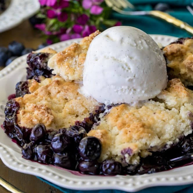 Plated blueberry cobbler with scoop of vanilla ice cream