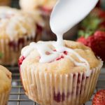 Drizzling glaze on a strawberry muffin