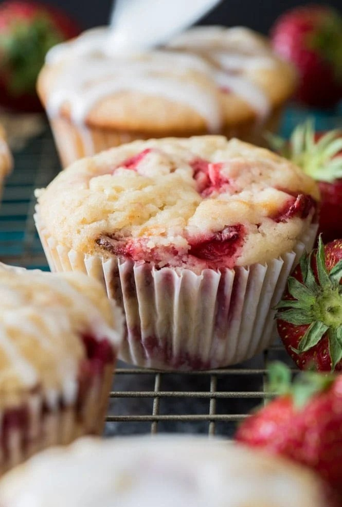 strawberry muffin on a cooling rack