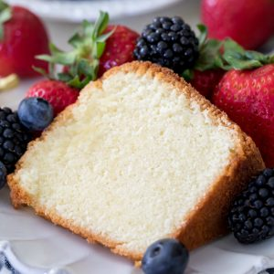 Pound cake slice surrounded by berries