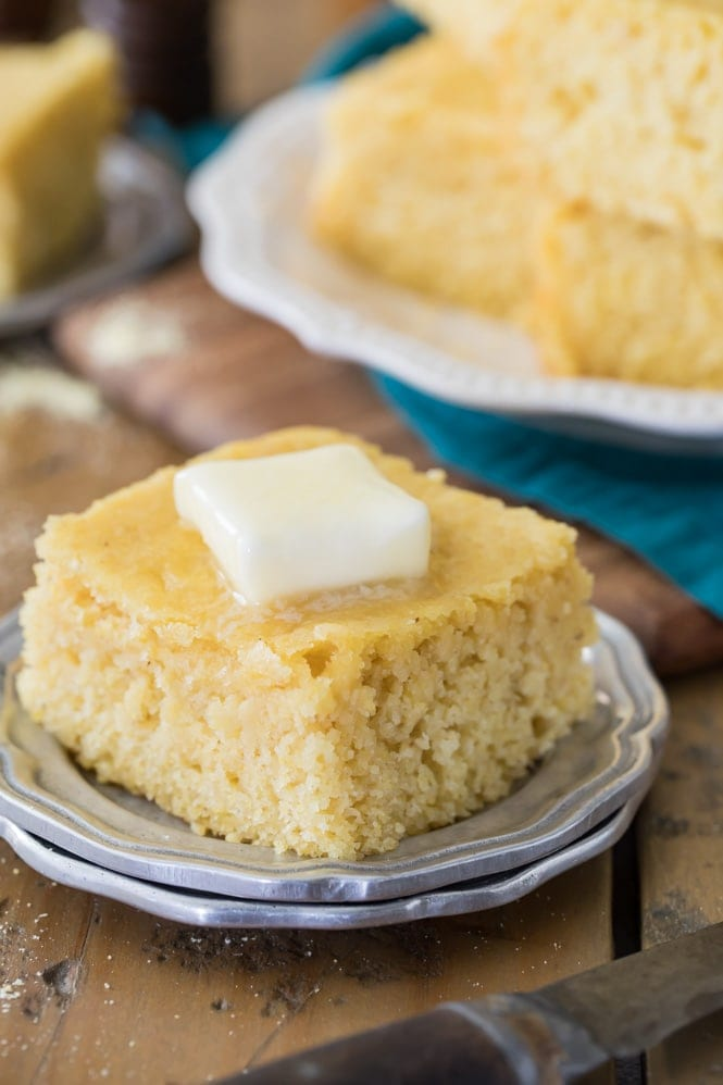 A piece of buttermilk cornbread with butter melting on top