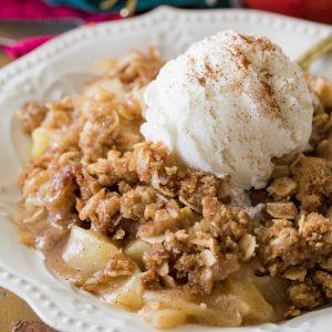 Apple crisp with scoop of vanilla ice cream